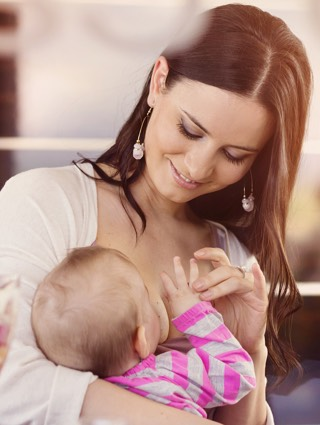 Breastfeeding in public is protected by law. Baby should each whenever he gets hungry.